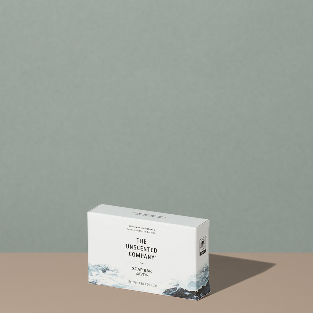 The Unscented Company biodegradable Soap Bar in a white cardboard rectangular packaging with black writings and foggy gray mountains