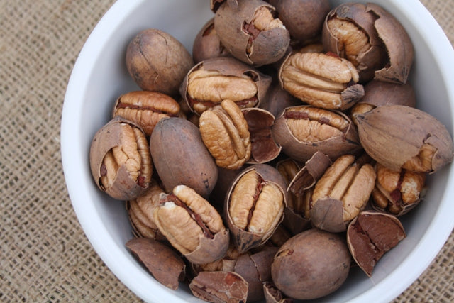 Fresh, Natural, Cracked Inshell Pecans | Royalty Pecan Farms on Highway 21 between Bryan/College Station and Caldwell, Texas.