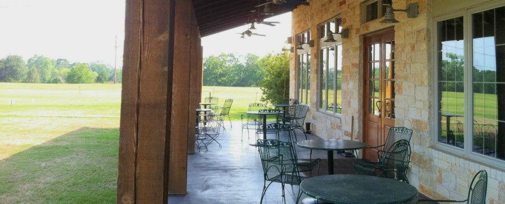 Relax on our covered veranda and enjoy the orchard view | Royalty Pecan Farms