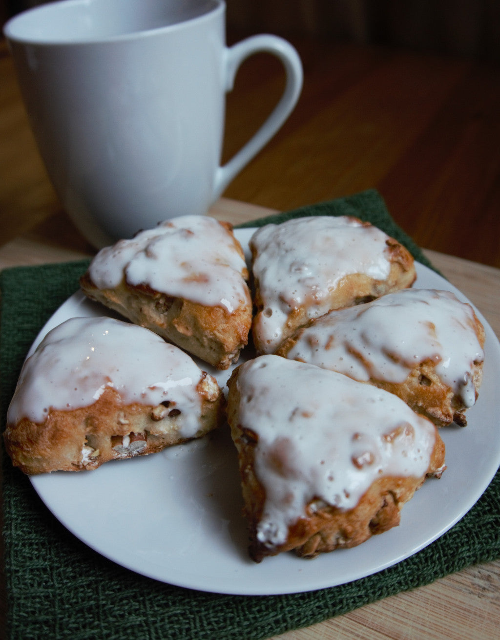 Cranberry Pecan Granola Scones topped with a maple yogurt glaze
