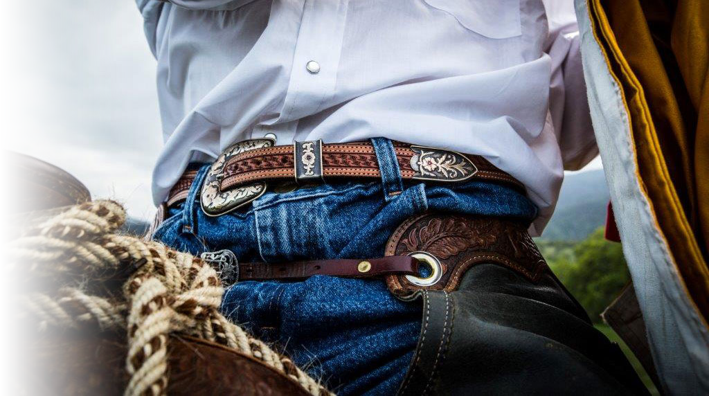 Hero shot of Silversmith Belt on Cowboy