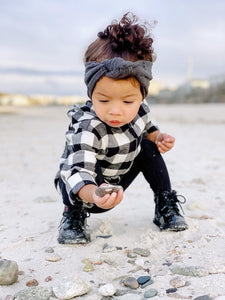 Mixed toddler girl on beach wearing plaid top + Infant Cable Knit Tights.