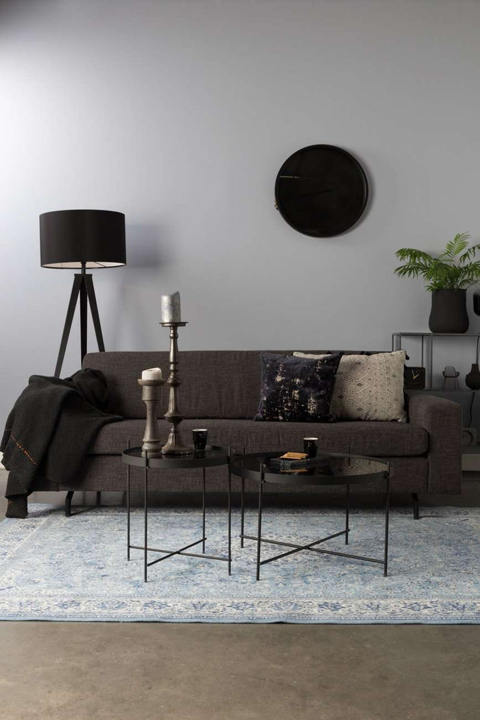 2.5 Jean Anthracite Seater Sofa presented in a living room setting with a grey and white carpet, grey walls and dark grey clock and lamp. Foxford Woollen Mills