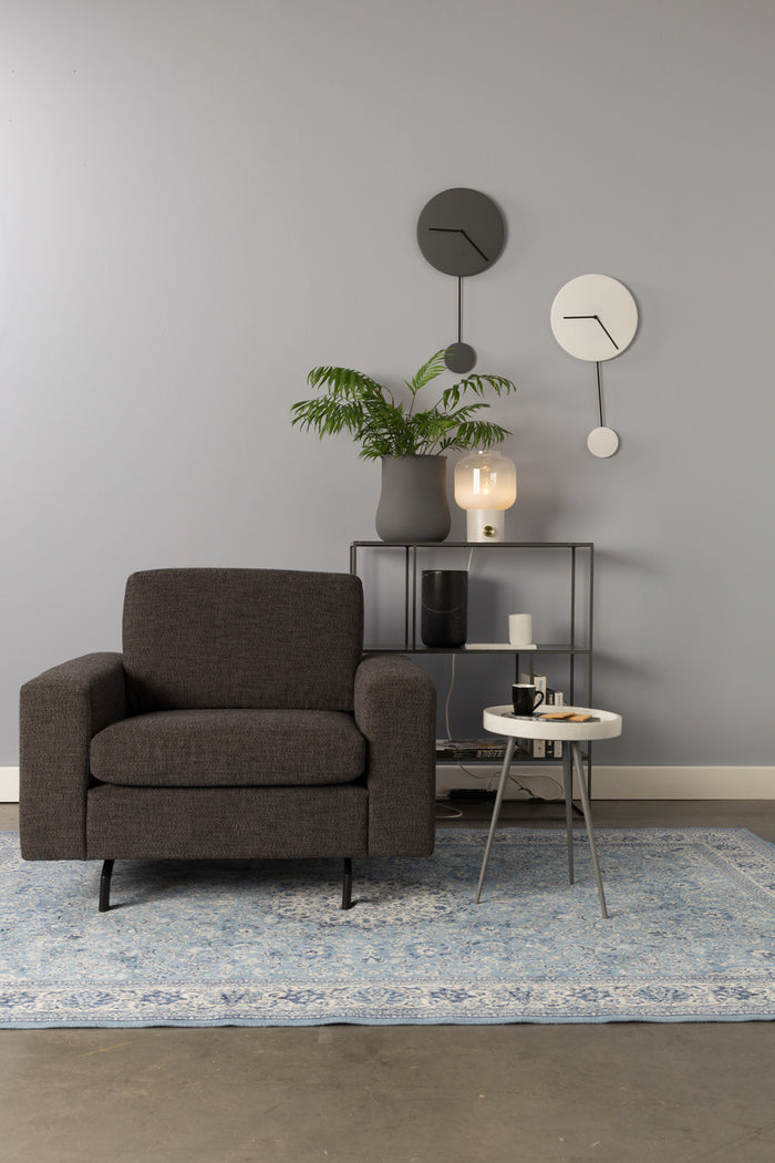 Anthracite Jean Sofa presented on a carpet in front of a grey wall with grey and white clocks. Foxford Woollen Mills