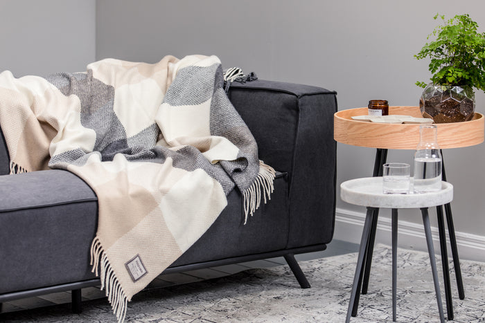 Block Check Cashmere Throw Draped across Grey Couch