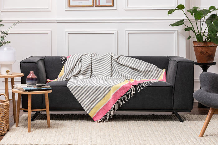 Foxford's Urban Candy Stripe Lambswool Draped across Grey Couch in Stunning Sitting Room