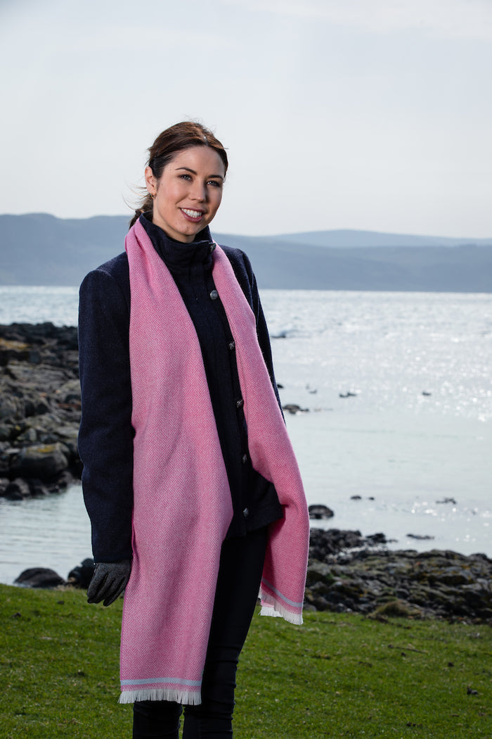 Woman wearing Foxford's Cerise & Willow Blue Scarf in the Irish Countryside