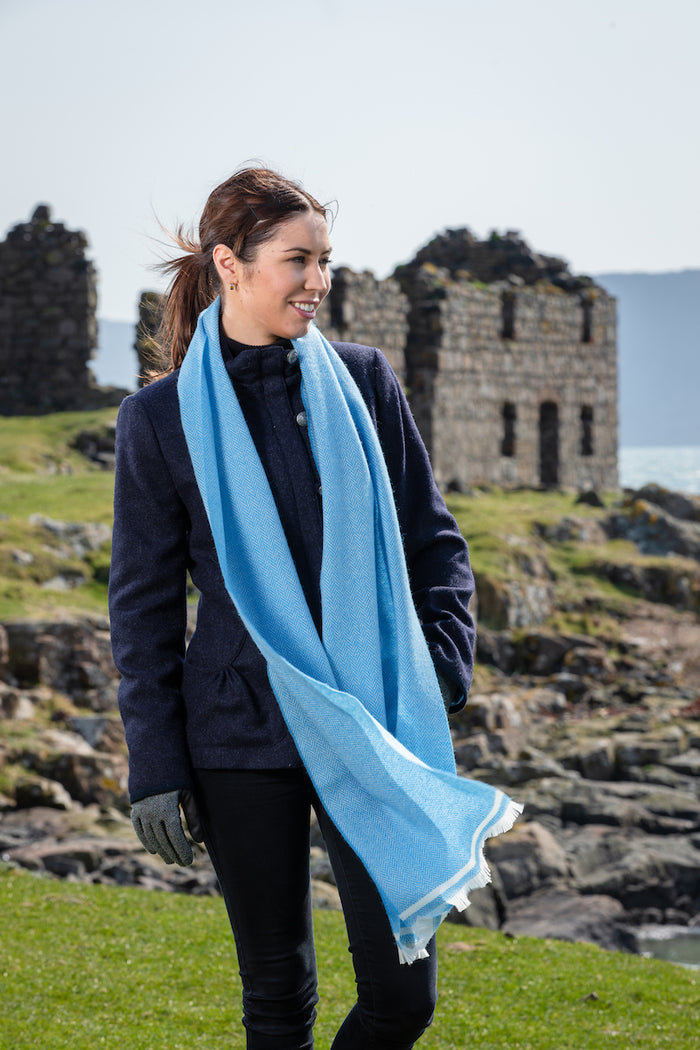 Woman wearing Foxford's Mayo Blue & White Scarf in Rural Ireland