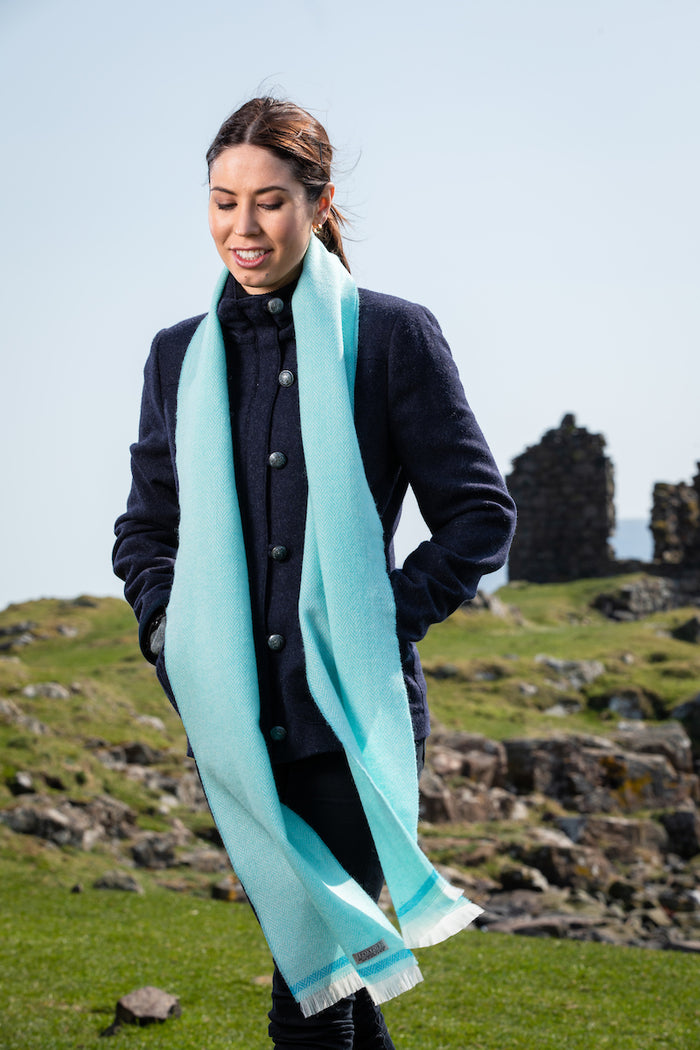 Woman wearing Foxford's Mid Turquoise & Jade Scarf in Rural Ireland