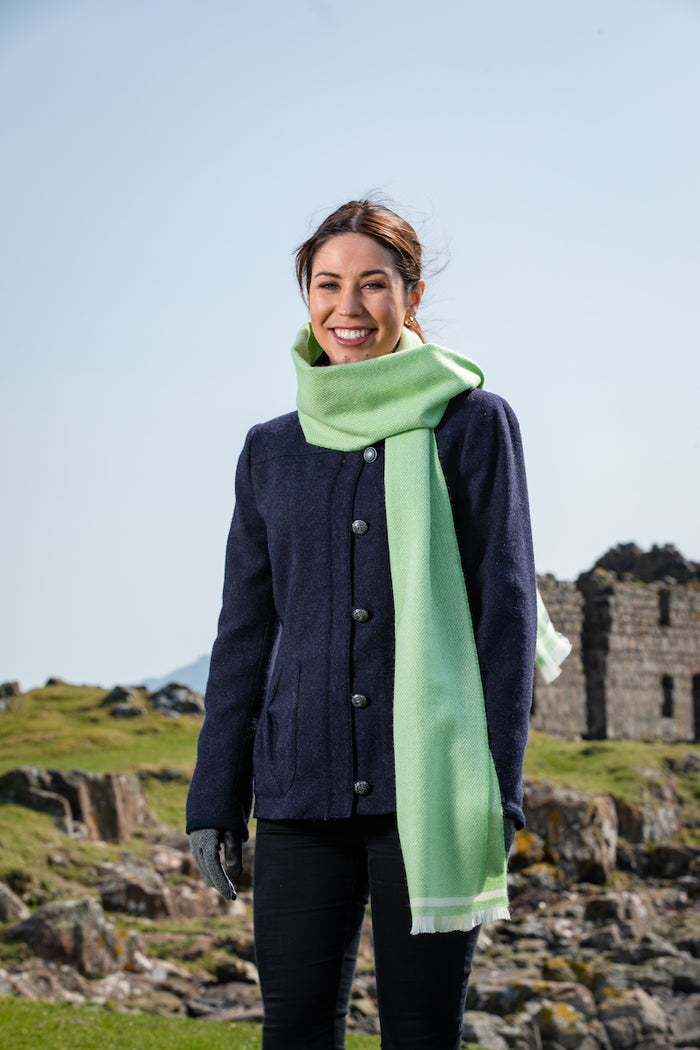 Woman wearing Foxford's Grass and White Scarf in Irish Countryside