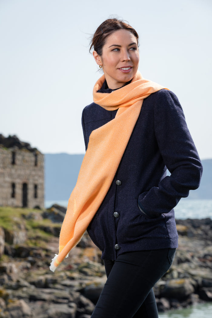 Woman in Irish Countryside wearing Foxford's Barcelona Orange, English Yellow Scarf