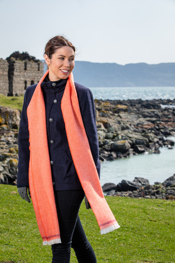 Woman wearing Foxford's Flame and Tomato Scarf in Irish Countryside