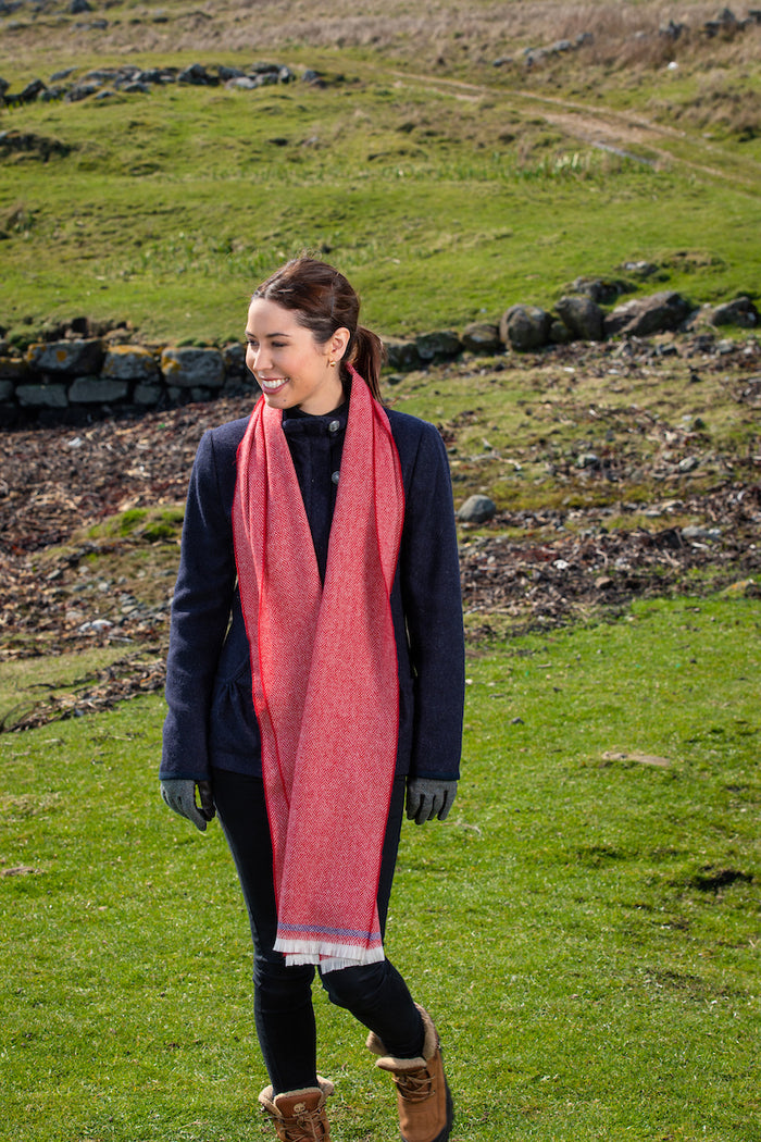Woman wearing Foxford's Tomato and Purple Scarf in the Irish Countryside