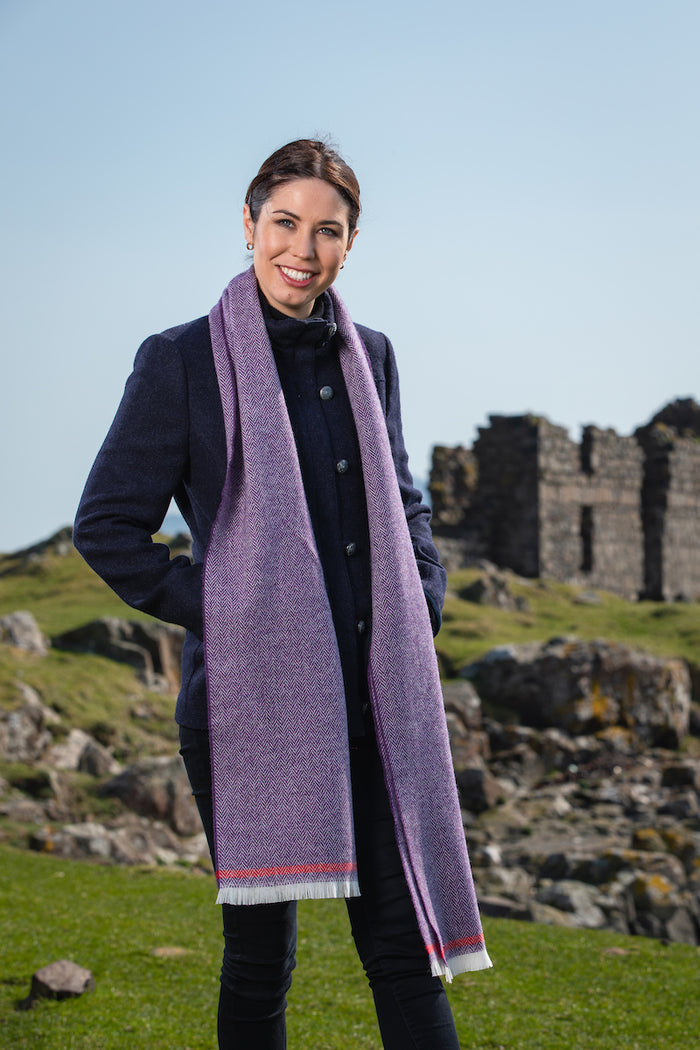 Woman wearing Foxford's Purple and Tomato Scarf in the Irish Countryside