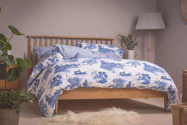 Bedroom shot of Foxford's Blue Willow Toile Duvet on wooden bed.  300 Thread Count and made from 100% Portuguese Cotton.