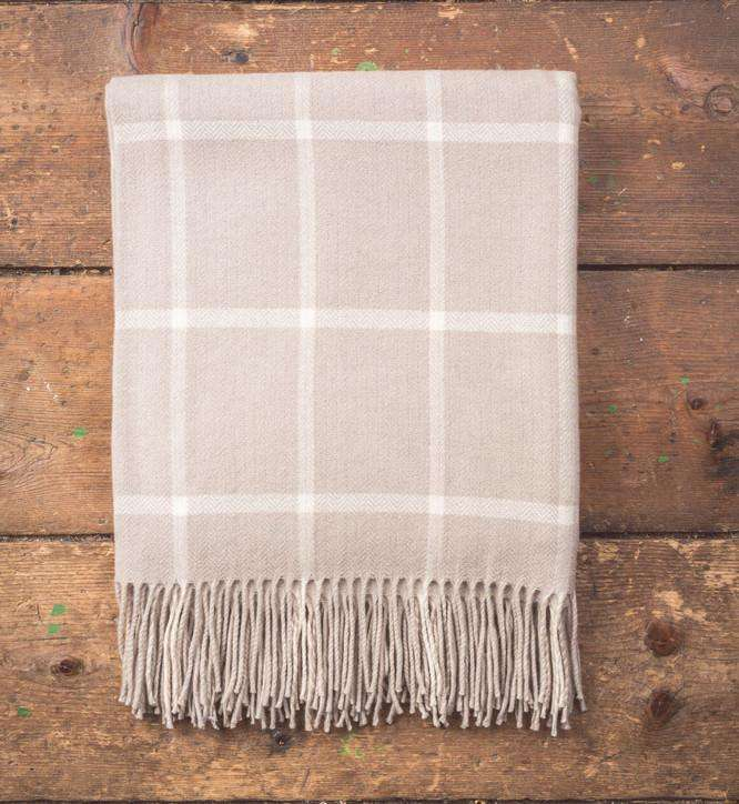 Bone & White Windowpane Lambswool Throw on Wooden Background