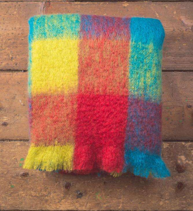 Coloured Check Mohair Throw folded on Wooden Background