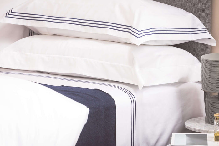Bedroom shot of Foxford's Navy Bed Blanket. Presented on a bed with Foxford's Navy 3 Row Egyptian Cotton Bed Linen.