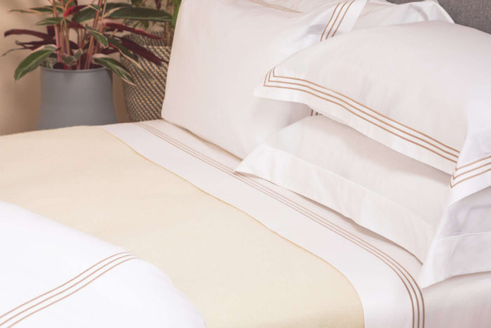 Bedroom Shot of Foxford's Cream Bed Blanket dressed with Foxford's 3 Row Egyptian Cotton Bed Linen