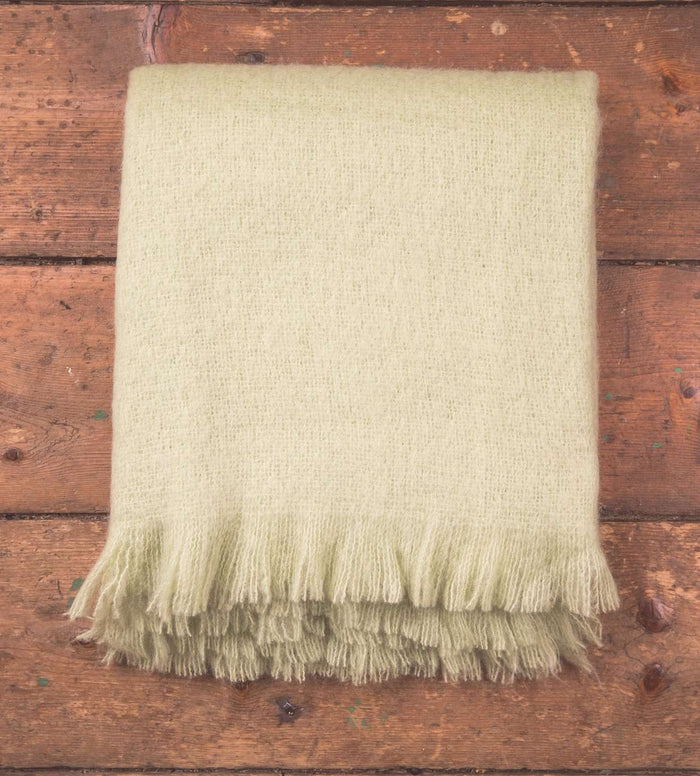 Lime Solid Mohair Throw on Wooden Floor