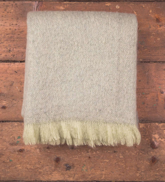 Lime & Sage Mohair Throw on Wooden Background