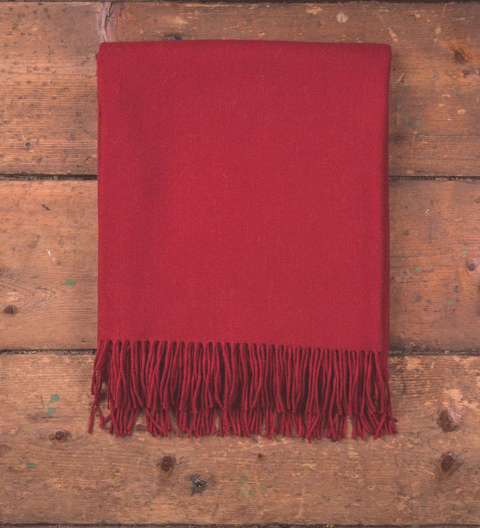 Foxford's Solid Red Throw on Wooden Floor