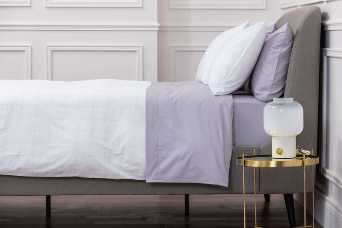 Bedroom shot of Foxford's Long Island White and Silver Duvet Cover. Presented on a bed in a white room. 100% Portuguese Cotton. Foxford Woollen Mills