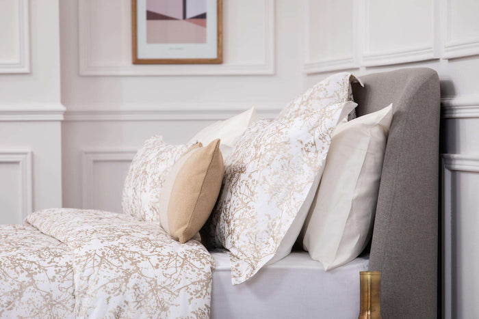 Bedroom shot of Foxford's Metallic Cobweb Oxford Pillowcase. Dressed with bone cushion and presented on a bed. 100% Portuguese Cotton. Foxford Woollen Mills