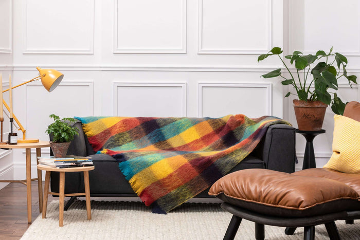 Striking Jewel Check Mohair Throw Draped Across Grey Couch