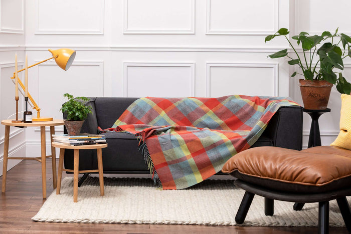 Foxford's Woodlands Check Lambswool Throw Draped Across a Grey Couch in Sitting Room