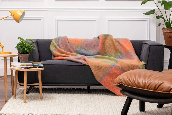 Foxford's Woodlands Giant Check Mohair Throw Draped Across Dark Grey Couch