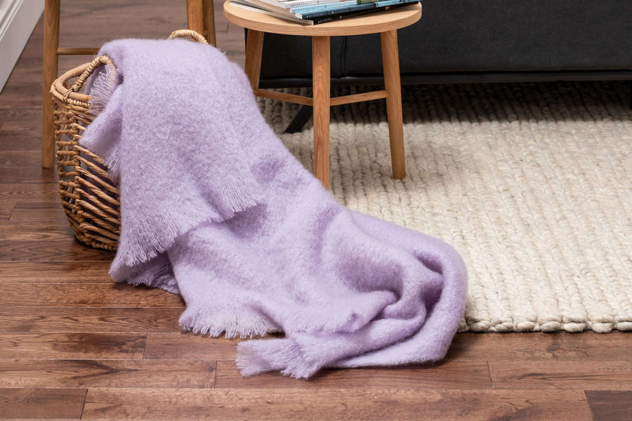 Heather Mohair Throw Draped out of Woven Basket