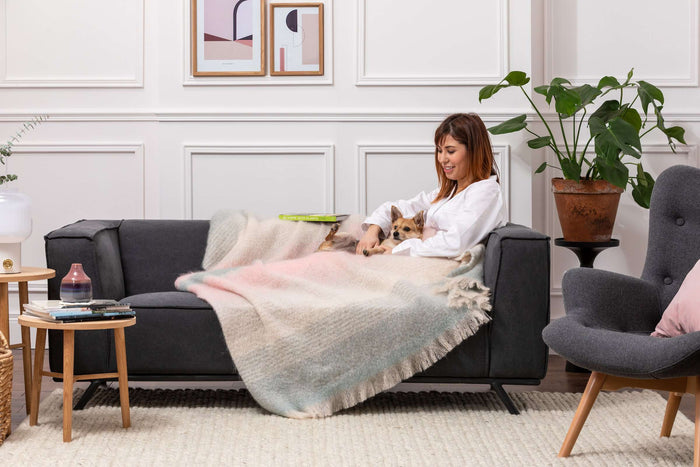 Woman & Dog wrapped up in Foxford's New Neutrals Ombreid Mohair
