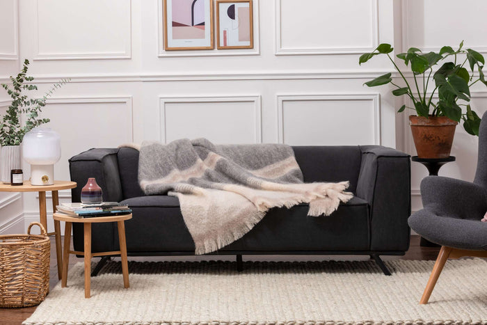 Classic Ombreid Stripe Mohair Throw Draped Across Grey Couch