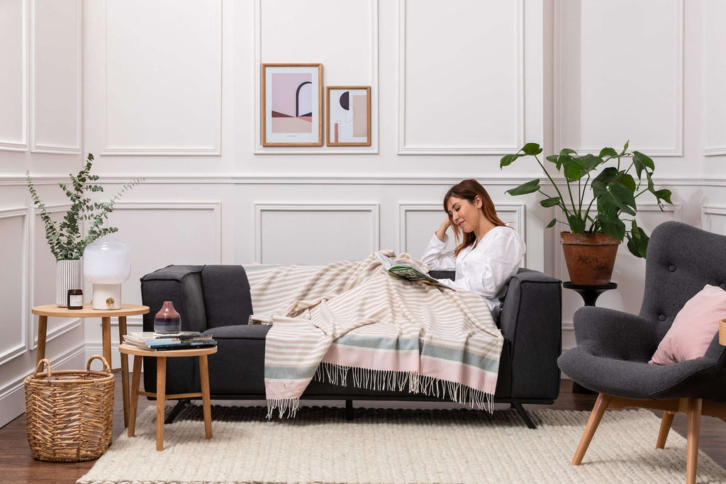 Woman wrapped up in Foxford's Candy Stripe Lambswool Throw