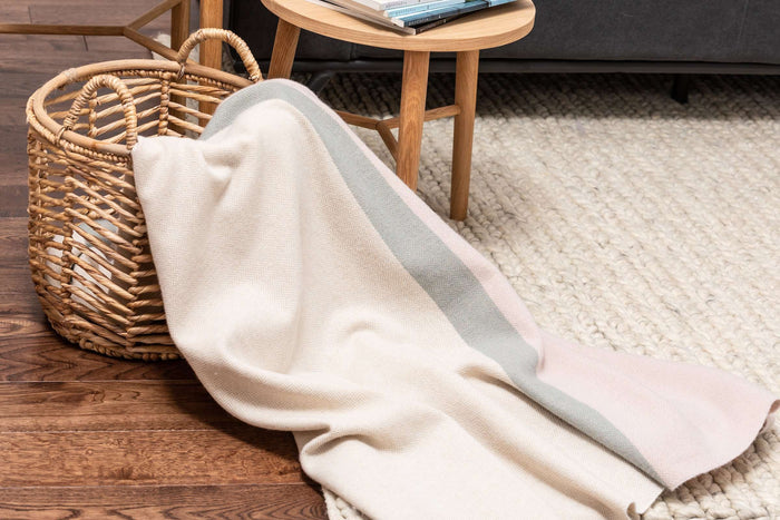 New Neutrals Block Stripe Lambswool Throw Draped out of Woven Basket