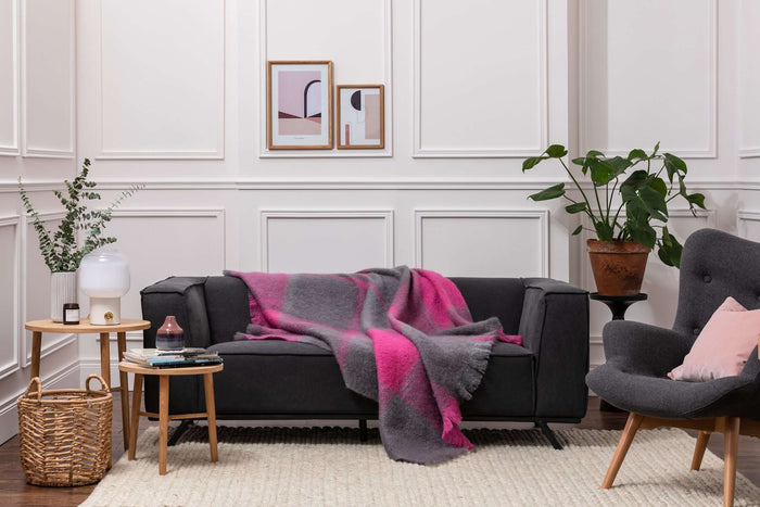 Foxford's Urban Giant Check Mohair Throw Draped Across Dark Grey Couch