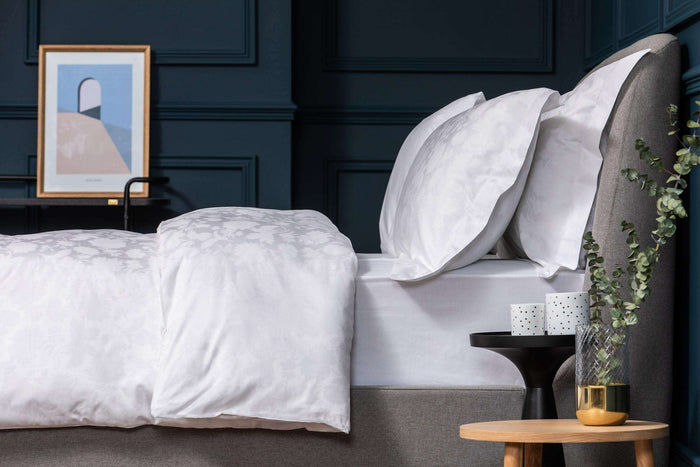 Bedroom shot of Foxford's Daisy Duvet Cover with Navy Walls. Foxford's Hotel Collection. Made from 100% Portuguese Cotton.