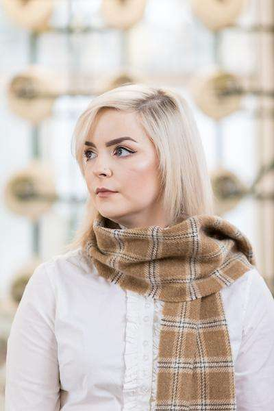 Woman wearing Foxford's Camel Check Scarf