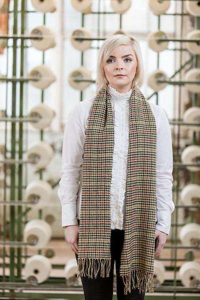 Woman wearing Foxford's Modern Houndstooth Scarf in Woollen Mill