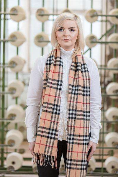 Woman wearing Foxford's Fawn, Black & Red Check Scarf in Woollen Mill