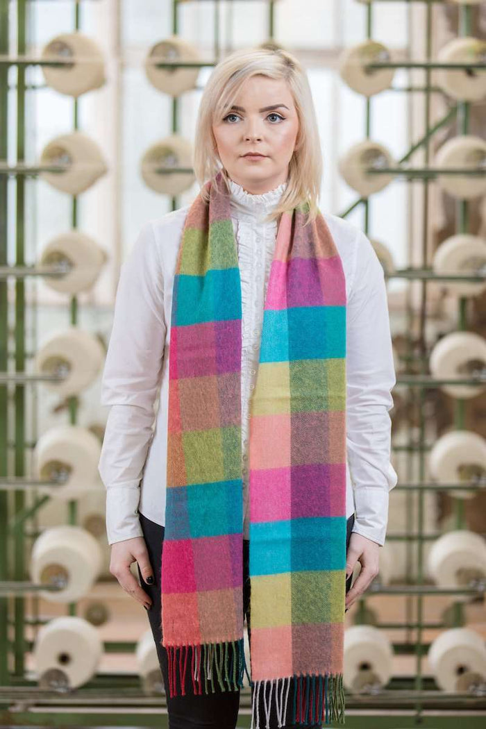 Woman wearing Foxford's Jade, Pink, Quinell Check Scarf in Woollen Mill