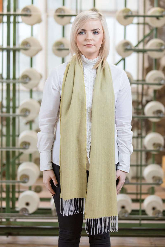 Woman wearing Foxford's Quinell & Silver Extra Fine Merino Scarf in Woollen Mill