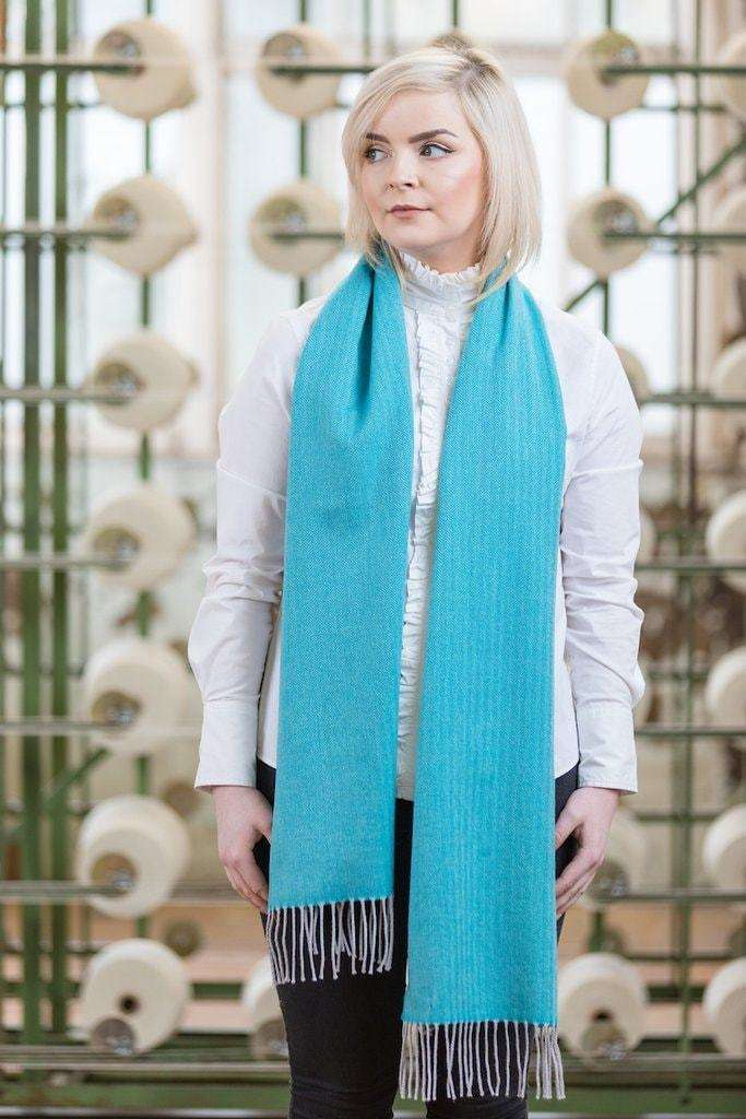 Woman wearing Foxford's Jade and Silver Extra Fine Merino Scarf