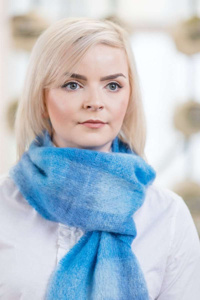 Woman wearing Foxford's Sky Blue Mohair Scarf