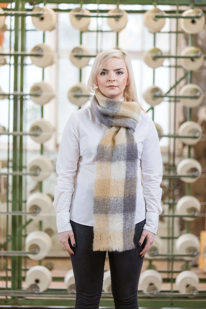 Woman wearing Foxford's Camel, White & Oxford Mohair Scarf in Woollen Mill