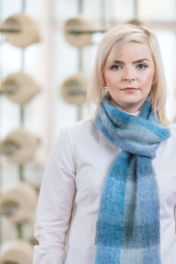 Woman wearing Foxford's Turquoise & Green Mohair Scarf in Woollen Mill
