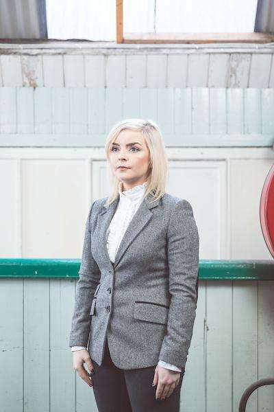 Woman wearing Foxford's Ladies Black & White Tweed Jacket in the Woollen Mill