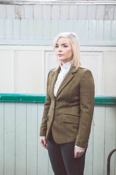 Woman wearing Foxford's Ladies Dark Green Check Tweed Jacket in the Woollen Mill