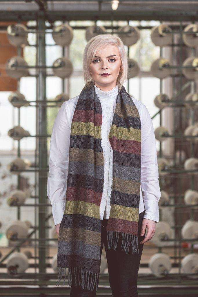 Woman wearing Foxford's Fall Thick Stripe Scarf in Woollen Mill
